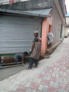 a-woman-labourer-carrying-baby-on-back-at-sun-point-mcleodganj